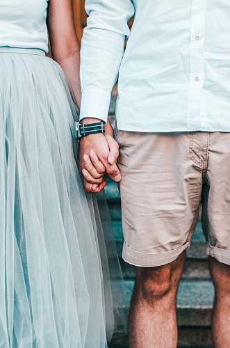 people man and woman holding hands while standing hand