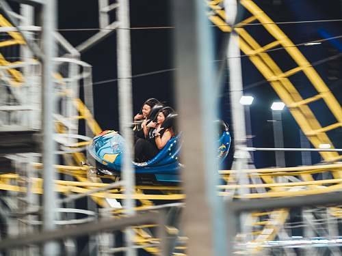 person man and woman on roller coaster people