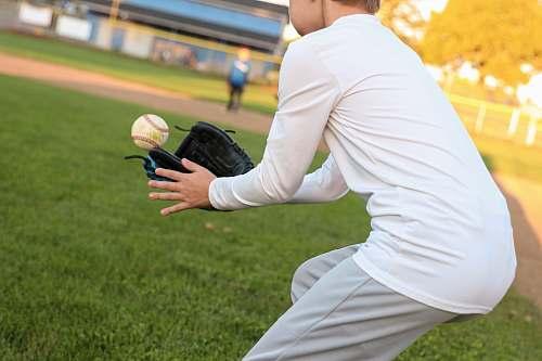 apparel man catching baseball clothing