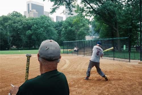person man holding baseball bat people