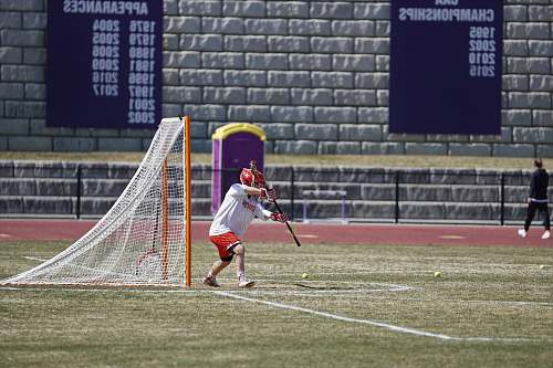 person man playing lacrosse at the field people