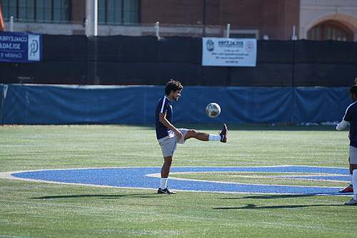person man playing soccer ball people