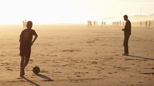 person man playing soccer nature