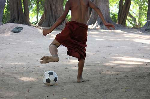 person man playing with soccer ball team