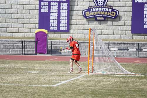person man standing in front of goalie net people