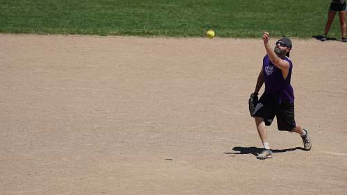 apparel man throwing baseball person