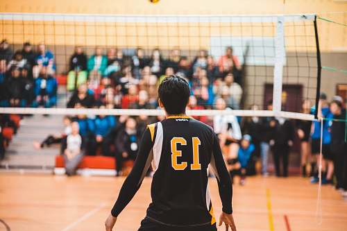 person man wearing black 13 volleyball jersey people