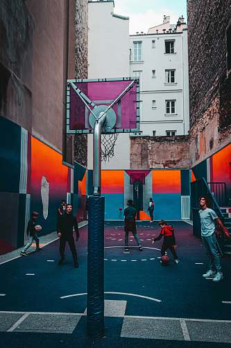 person men and children playing basketball pedestrian