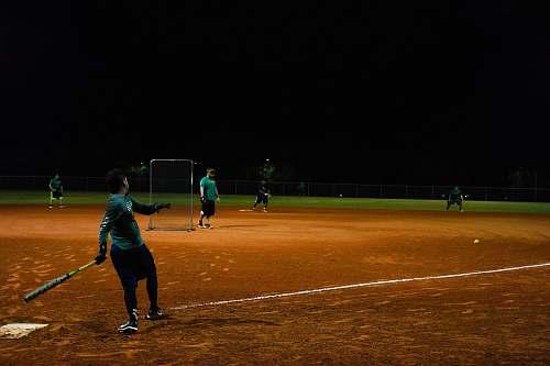 person men playing baseball during nighttime people