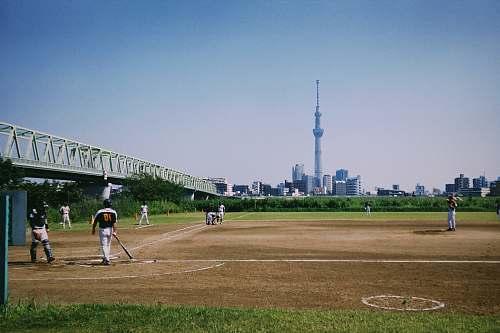 person men playing baseball building