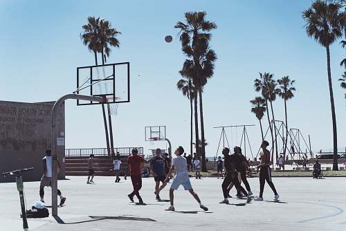 person men playing basketball during day people