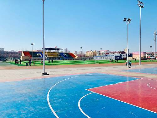 person outdoor basketball court and tennis court people