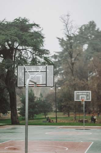 person outdoor basketball court during daytime people