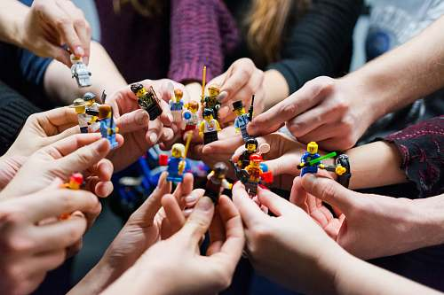 person people holding miniature figures finger