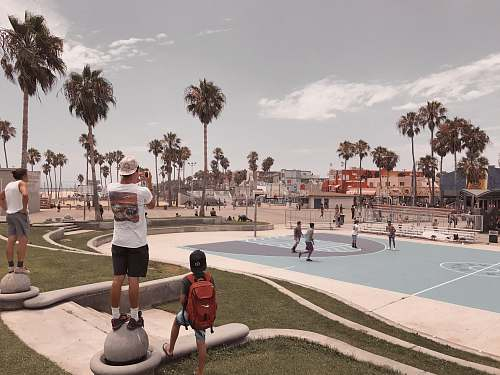 person people on basketball court during daytime building