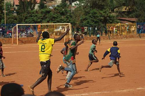 person people running on soccer field during daytime sport