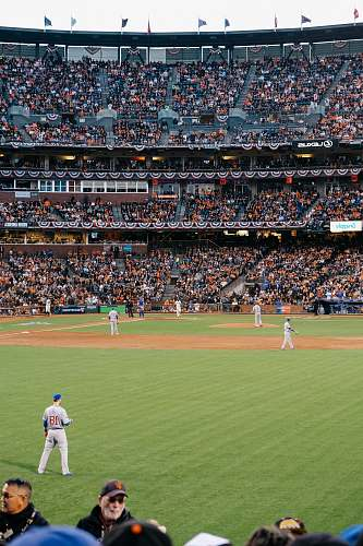 crowd photo of baseball players in stadium during daytime baseball