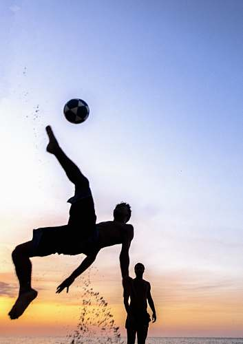 person silhouette photography of person playing soccer sphere