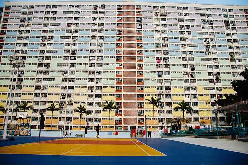 person tennis court in front of building during day building