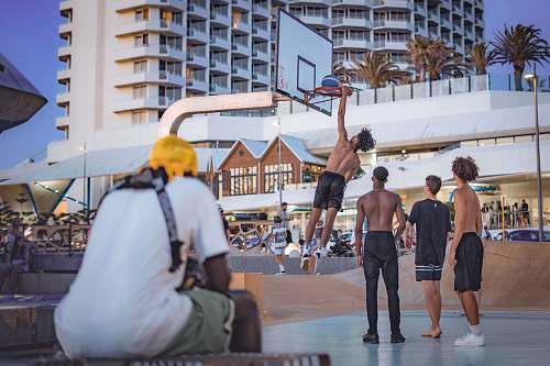 person topless man dunking basketball apparel