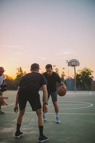 person two guy playing basketball during daytime people