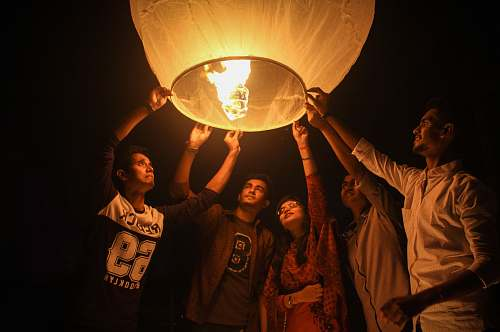 person woman and men holding on a paper lantern bangladesh