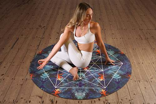 person woman doing yoga on mat people
