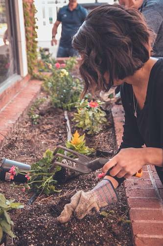 outdoors woman holding garden fork garden