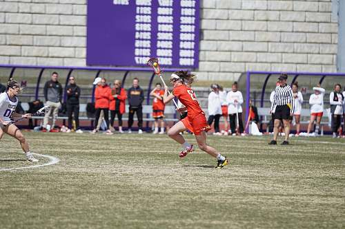 person woman playing lacrosse on the field people
