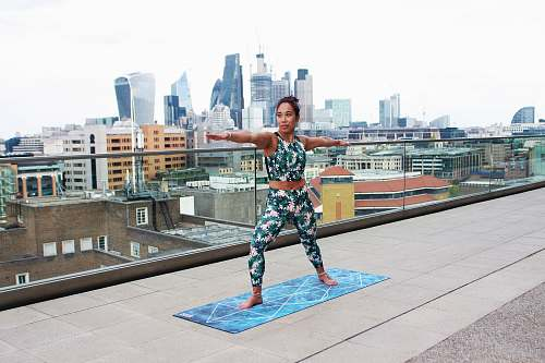 person woman stretching in top of building people