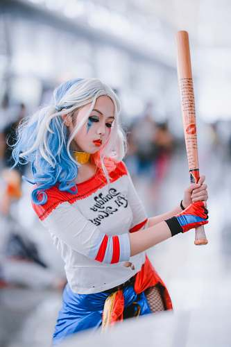 person woman wearing harley quinn costume costume
