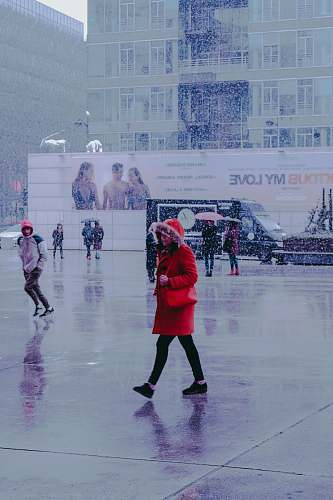 person woman wearing red coat skating