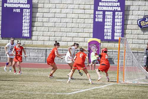 person women playing lacrosse sport people