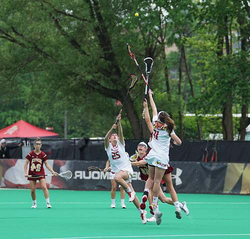 person women's lacrosse competition people