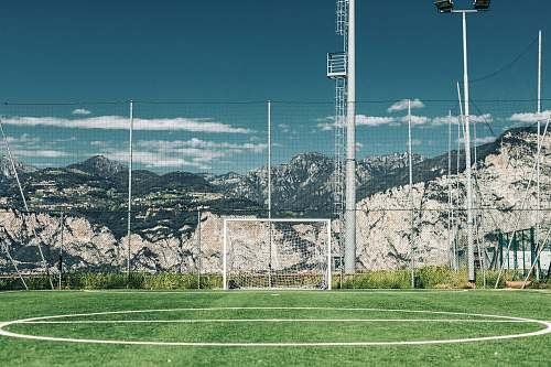 sports soccer field in distant of mountain football