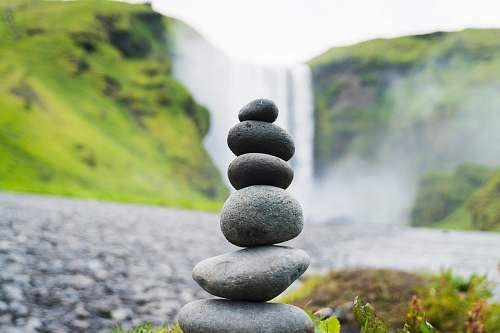 iceland cairn stone in Skogafoss Falls, Iceland rock