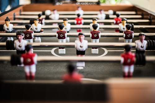 human brown foosball table closeup photography person
