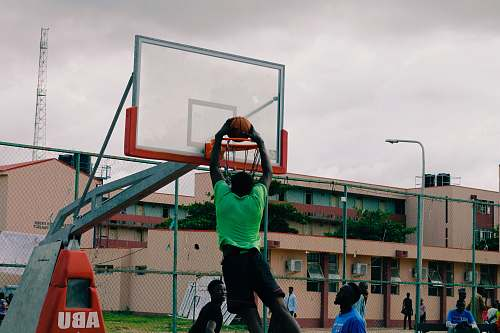 human man dunking the basketball person