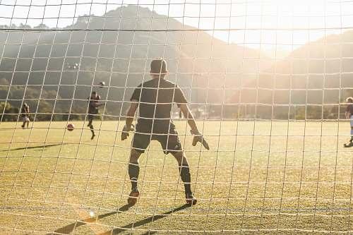 human men playing soccer person