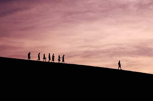 silhouette silhouette of people on hill sky