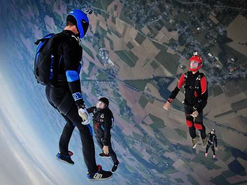 sport aerial photography of three people skydiving sports