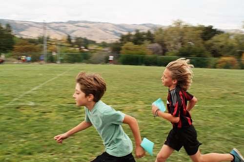 human boys running on field people