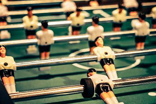 human close up photography of foosball table people