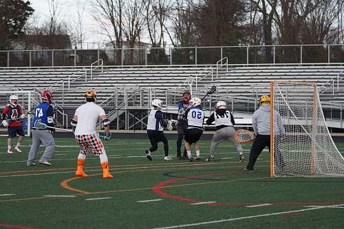 human lacrosse players on field people