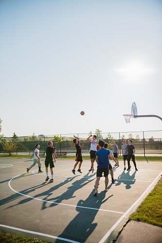 human people playing basketball people