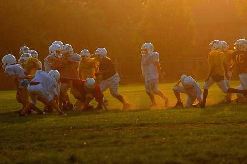 human people playing football people