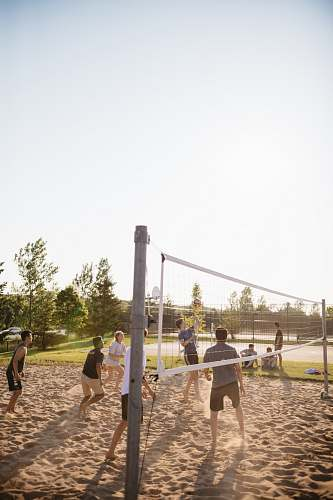 human people playing volleyball people