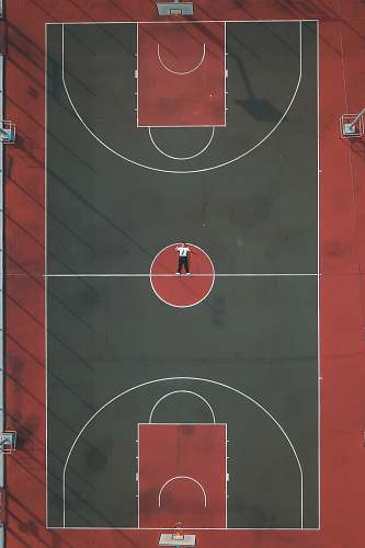 basketball person lying in the middle of basketball court basketball court