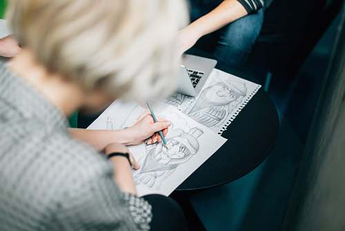 reading person wearing gray shirt sketch working