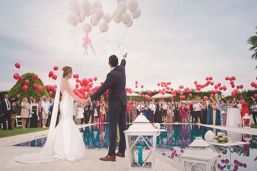 people photo of a man and woman newly wedding holding a balloons wedding